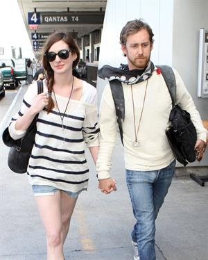 Anne Hathaway arrives at LAX airport in Los Angeles on September 3, 2011