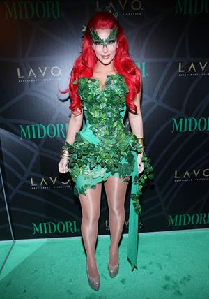 Kim Kardashian as Poison Ivy for the 2011 Midori Green Halloween party in New York