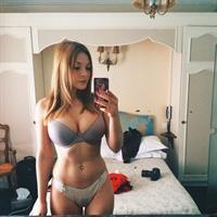 Olga Kobzar in lingerie taking a selfie