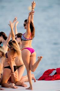 Nina Dobrev in a bikini - ass
