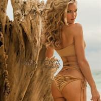 Joy Corrigan in a bikini - ass