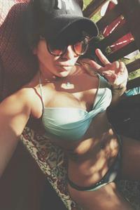 Alicia Michaela in a bikini taking a selfie