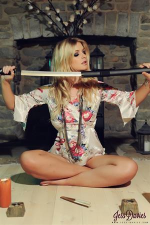 Jessica Davies posing with a sword