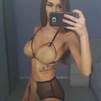 Lily Ermak in lingerie taking a selfie