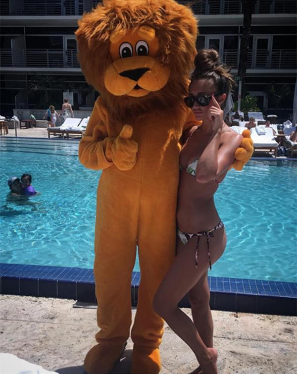 Megan McKenna with a lion mascot