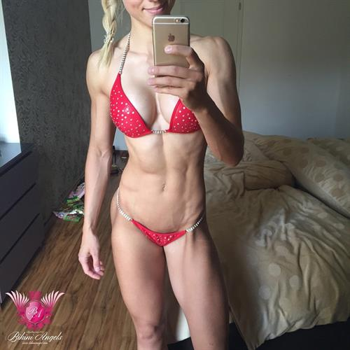 Adrienne Koleszár in a bikini taking a selfie