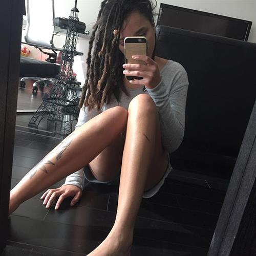 Sasha Lane taking a selfie