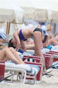 Katie Cassidy in a bikini - ass