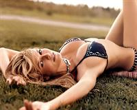 Heidi Klum in a bikini laying on her back