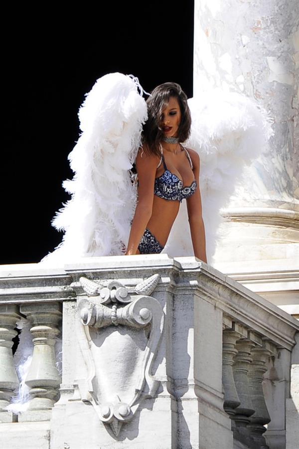 Lais Ribeiro leaning on a Parisian balcony