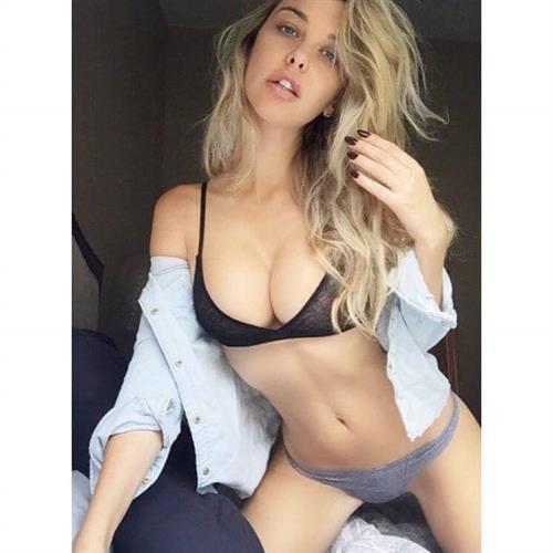 Emily Sears in lingerie taking a selfie