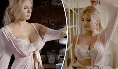 The Baywatch star capitalized on her gorgeous body, flaunting it with hot lingerie and a sizzling robe.