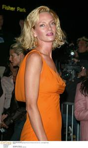Uma Thurman in an orange dress