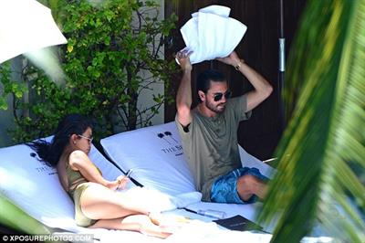 Kourtney and Scott enjoyed each other's company side-by-side on their lounges.