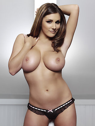Lucy Pinder posing topless in a tiny thong