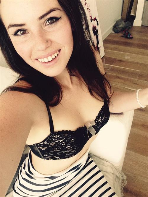 Alexis Young in lingerie taking a selfie