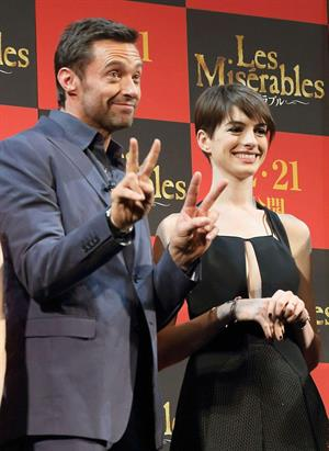 Anne Hathaway poses for photographers during an event to promote their latest movie 'Les Miserables' in Tokyo
