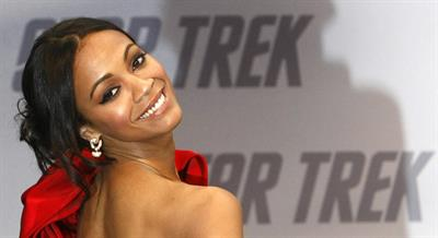 Zoe Saldana poses on the red carpet during the German premiere of the movie Star Trek April 16