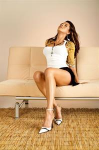 Alicia Machado posing on bamboo floor