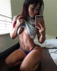 Miss Genii in lingerie taking a selfie