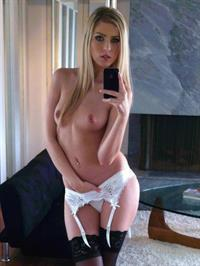 Abigaile Johnson taking a selfie and - breasts