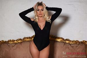 Big tit blonde Stacey Robyn strikes a pose