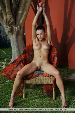 Gloria Sol nude in a red chair for Met-Art