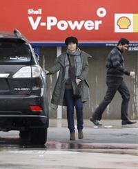 Dannii Minogue - Pictured getting a little wet while filling up on petrol - 09th August 2012