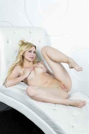 Lisa Dawn nude on a white chair