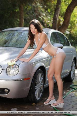 Rylee Marks washes a car for Met-Art