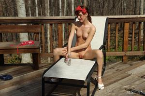 Alaura Lee nude on a lawn chair