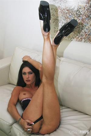 Jessica Jaymes nude on a couch for Cherry Pimps