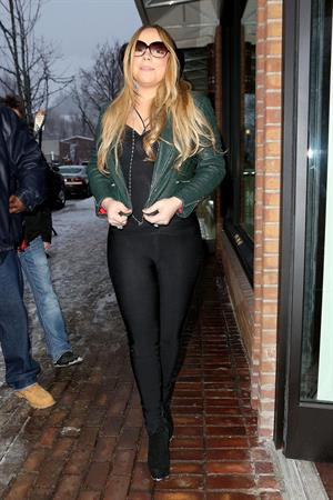 Mariah Carey made another stop at the Louis Vuitton store to shop with a family member. December 24, 2012
