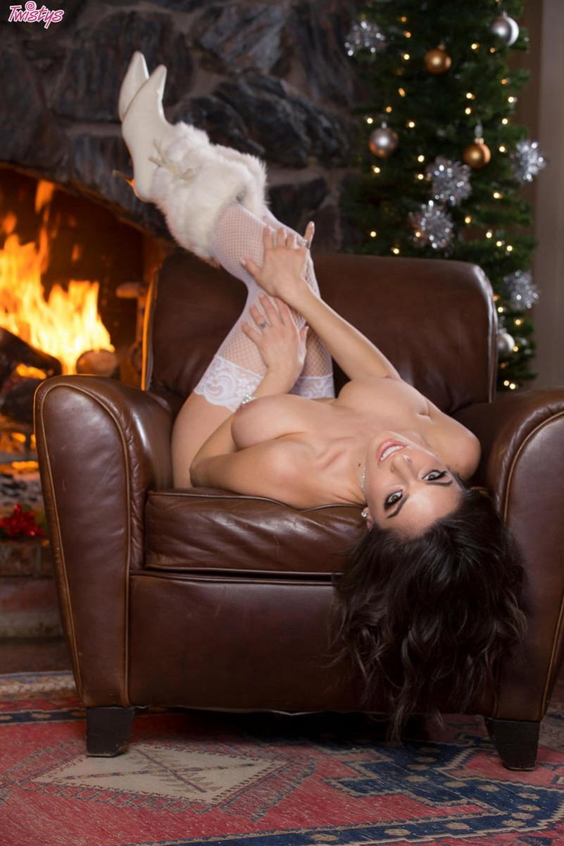 Darcie takes off her red lingerie in front of the fireplace