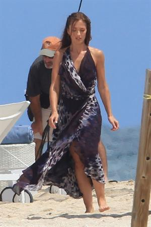 Minka Kelly on the set of Charlie's Angels on a beach in Miami 02-09-2011