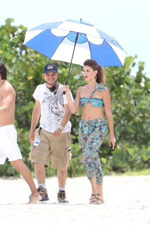 Minka Kelly filming Charlie's Angels on a beach in Miami 02-09-11