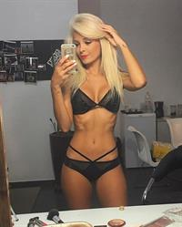 Jhenny Andrade in a bikini taking a selfie