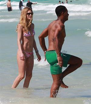 Doutzen Kroes enjoys a day on the beach in Miami Beach, FL on April 28, 2013