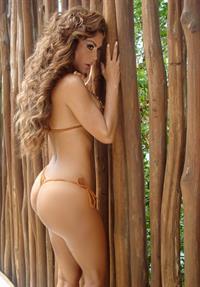 Ninel Conde in a bikini - ass