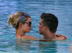 Paris Hilton poolside at their Miami hotel December 7-2012