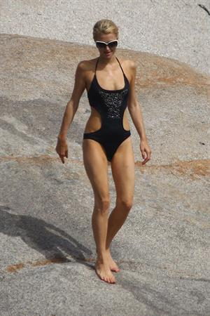 Paris Hilton - Wearing a swimsuit at a beach in France August 6, 2012