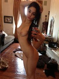 Vanessa Hudgens taking a selfie and - breasts