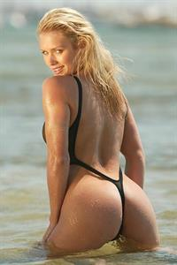 Nicky Whelan in a bikini - ass