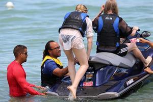 Chloe Grace Moretz candids in a Black Bikini in Miami Beach
