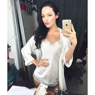 Mia Kang taking a selfie