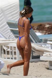 Sofia Jamora sexy ass in a thong bikini at the beach seen by paparazzi showing nice cleavage.