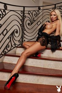 Bethany Giura nude playboy photo shoot showing her topless big boobs in see through black lingerie.