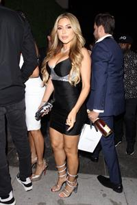 Larsa Pippen big boobs showing nice cleavage wearing a tight black dress that shows off her tits seen by paparazzi.