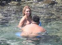 Katie Price caught nude with her son by paparazzi showing her topless boobs.