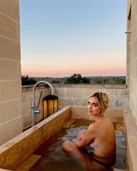 Chiara Ferragni topless new photos in an outdoor bathtub showing off nice sideboob with her nude big tits wearing just thong bikini bottoms.